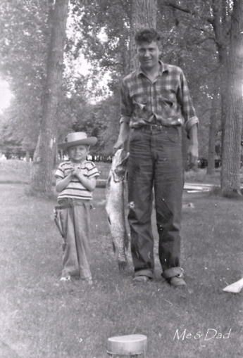 young girl in cowboy hat, standing next to father, who's holding a stringer with a large fish