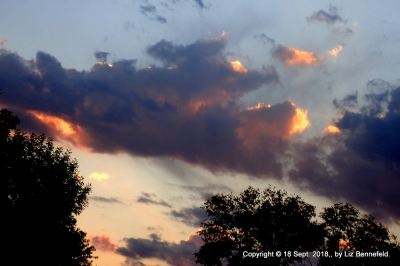 red and grey clouds at sunset