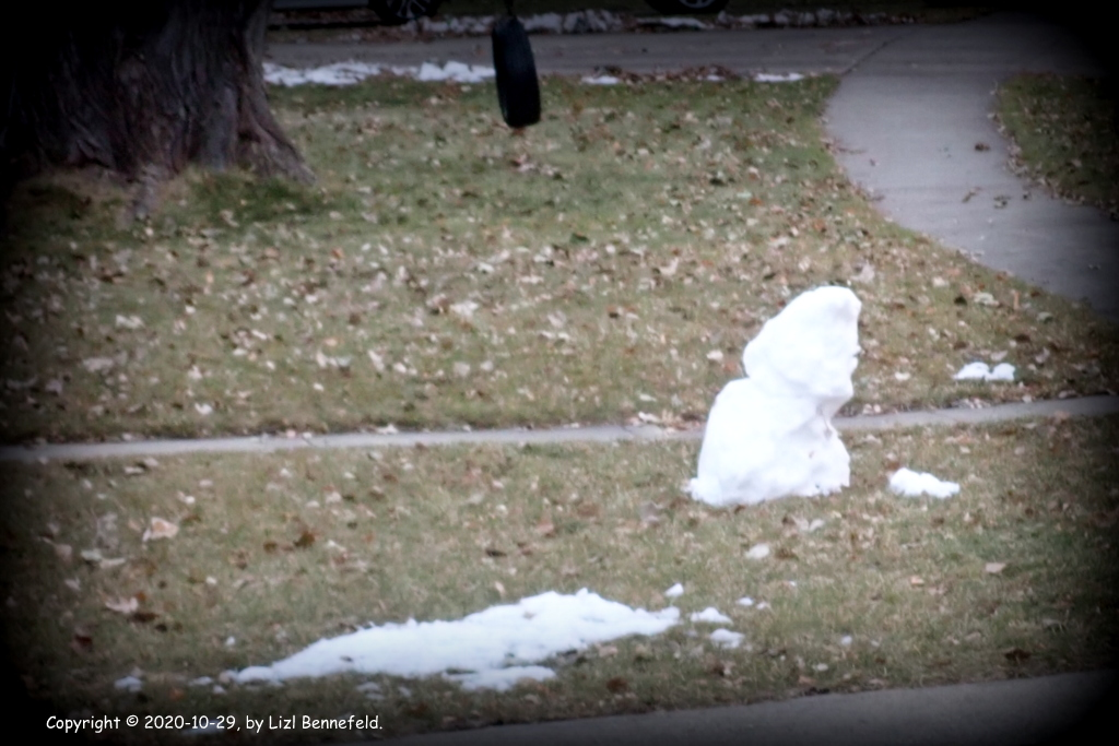 melting snowman on thawing lawn