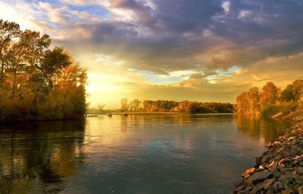 dawn/dusk gold light on river sun middle left