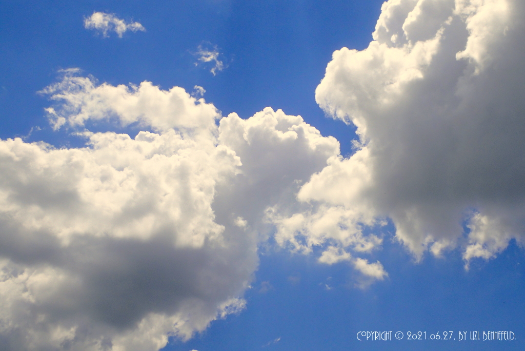 early summer clouds and blue sky